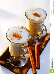 two mugs of frothy chocolate with cinnamon stock image image