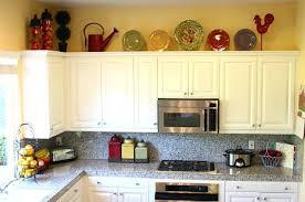 top of kitchen cabinet decor ideas decorate top of kitchen cabinets photos decorating above kitchen