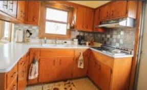 how to upgrade kitchen cabinets on a budget updating plywood kitchen cabinets painting vs refacing vs replacing