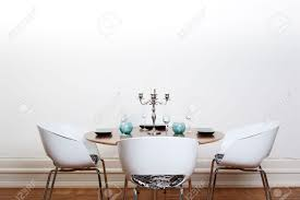 White Chairs Modern Dining Room With A Round Table And White Chairs And