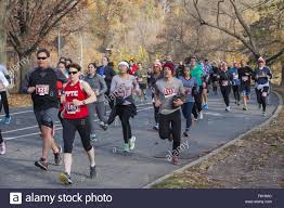 running in the annual turkey trot five mile run on stock