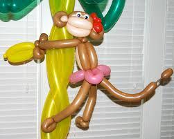 the graduate u0026 large monkey in a palm tree balloon decor