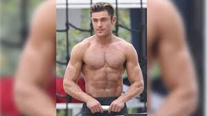 zac efron looks shredded after with the rock