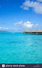 overwater bungalows in moorea french polynesia stock photo