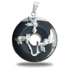 beautiful pendant in black onyx with the trilogy the holy power