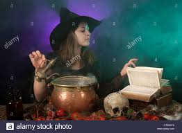 halloween witch on smoky green and purple background stock photo