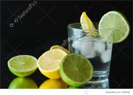 green cocktail black background lemon and lime drink with ice on black background stock photo