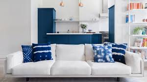 blue furniture white arrow renovates queens rowhouse with navy millwork and