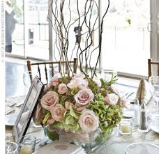 curly willow centerpieces curly willow branches sprung from low arrangements of pink roses