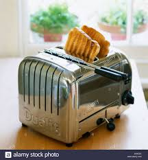 Dualit Stainless Steel Toaster Dualit Toaster With Toast In Kitchen Stock Photo Royalty Free