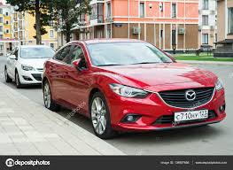 mazda worldwide sales new red mazda 6 atenza parked near modern houses stock