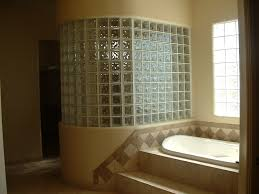 master bath with glass block tile shower wall and diagonally set