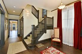 simple wooden rail stair with vintage high back armchair and