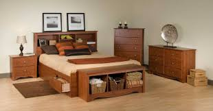 hickory wooden queen bed with shelving headboard also side drawers