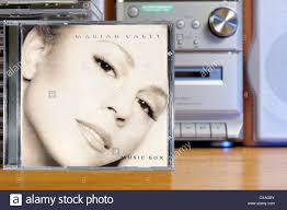 carey album box piled cd cases stock