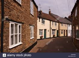 terraced row of beautiful old painted english cottages in narrow