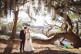 charleston wedding photographers wedding at the tides on folly sc amelia dan