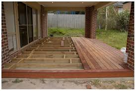 wood deck concrete patio bordered edge rather than