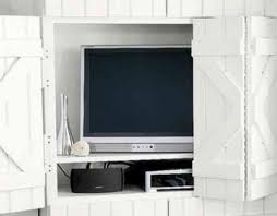 meuble tv caché cacher sa télé avec une porte coulissante 48 idées intéressantes
