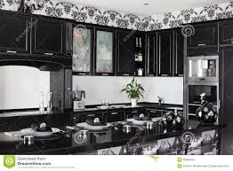 black and white modern kitchen with stylish furniture royalty free