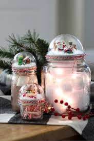 Plastic Storage Containers For Christmas Ornaments by How To Make A Mason Jar Lid Snow Globe For Christmas Using A Clear
