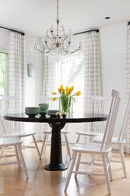 Contemporary Country Dining Room Features A Round Black Dining - Black and white dining table with chairs