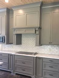 gray kitchen cabinets with white crown molding i like the big cove crown molding with the shaker style