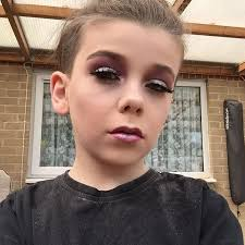 crossdresser putting makeup young boy does his own sassy af make up doesn t give a s t what
