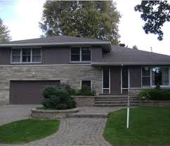 exterior dark gray shingles black roof shutters with white house
