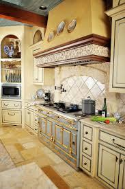 tuscan kitchen with large range hood choosing kitchen range hood