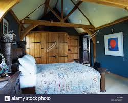 Dark Blue Bedroom by Built In Wardrobes With Unpainted Wooden Doors In Dark Blue
