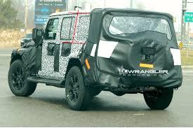 green camo jeep 2018 wrangler drops camo shows backup camera roofline grab