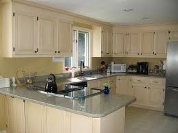 Painting Old Kitchen Cabinets Before And After Wonderful Cream Painted Kitchen Cabinets Have Such A Throughout Decor