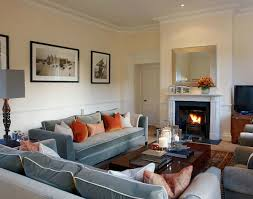 gray sofa orange accents white mantel fireplace comfy casual