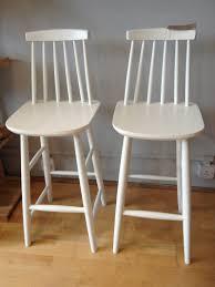 three white acrlic adjustable bar stool with round steel pedestal