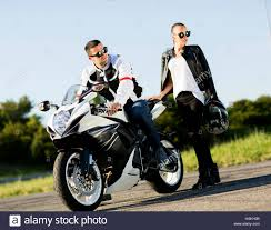 motorcycle riding leathers man and woman wearing leather jackets and stylish sunglasses