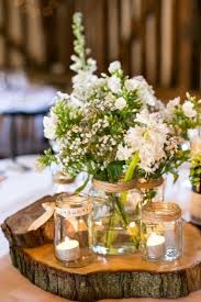 jar decorations for weddings white and green flowers with jar wedding centerpiece deer