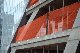 curtain wall installation underway at 82 story 145 unit 1 050