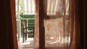 Balcony Door Curtains Room With Open Balcony Doors Curtains Are Blown By The Wind