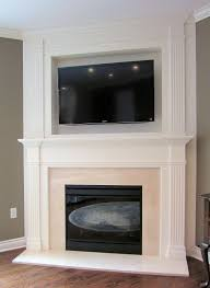 corner white fireplace with white mantel shelf over black metal