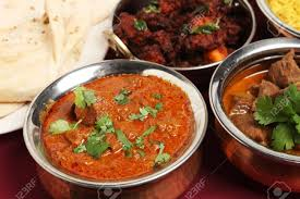 kashmir indian cuisine a bowl of kashmiri curry on a table with korma chicken