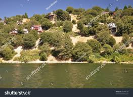 hillside homes sit above the shoreline of scenic lake gregory in