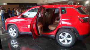 red jeep compass meeting the jeep compass edit priced between 14 95 to 20 65