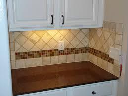 tile borders for kitchen backsplash travertine subway tile kitchen backsplash with a mosaic glass tile