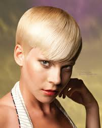 gamine hairstyles for mature women short and sleek gamine cut with curved bangs for boyish charm