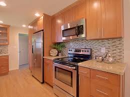 beautiful maple shaker kitchen cabinets featuring brown color
