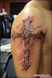 grey ink cross tattoo on right arm tattoo viewer com