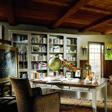 simple small home library design photo with nice book cabinets