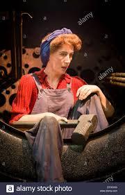 female boiler maker waiting for next red rivet in manufacture
