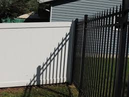 white vinyl privacy fence mixed with 6 high spear top black